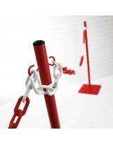 Poste metálico rojo para catenaria